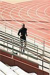 Man running bleachers