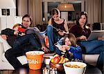Family spending leisure time in living room