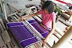 Young Batak tribeswoman weaving sarong with traditional Batak Toba design, Buhit, Samosir Island, Lake Toba, Sumatra, Indonesia, Southeast Asia, Asia
