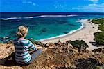 Tourist enjoying the beautiful scenery of Barbuda, Antigua and Barbuda, West Indies, Caribbean, Central America