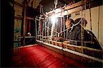 A weaver at work making a sari in Chanderi, a famous sari producing town in Chanderi, Madhya Pradesh, North India, Asia