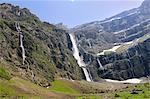 Waterfalls cascade down the karst limestone cliffs of the Cirque de Gavarnie, Pyrenees National Park, Hautes-Pyrenees, France, Europe