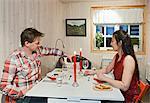 Couple having dinner in chalet
