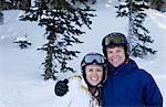 Young couple wearing skiwear