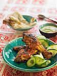 Tandoori chicken with sliced cucumber