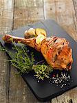Roast leg of lamb with garlic and onion stuffed under the skin