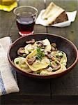 Cheese raviolis with peas and mushrooms