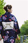 Japanese woman in a Yukata walking away