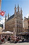 Leuven, Belgium. Street cafe in front of Leuven's mid-15th century town hall.