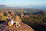 Europe, Bulgaria, Belogradchik, hiker on rock formations at Kaleto Rock Fortress (MR)