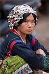 Laos, Muang Sing. Akha lady at the local market.