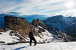Europe, Swiss Alps, Switzerland, Bernese Oberland, Trubelstock (2998m), hiker on snow field (MR)