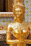 Thailand, Bangkok.  A Kinnari statue at Wat Phra Kaeo, Temple of the Emerald Buddha, within the grounds of the Royal Grand Palace.