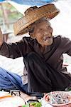 Thailand, Bangkok. Old lady at Damnoen Saduak Floating Market.