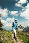Mature woman hiking in mountains, Tannheim Valley, Austria