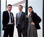 Portrait of three business colleagues in doorway