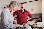 Senior couple baking