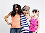 Three girls wearing sunglasses