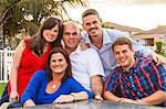 Portrait of family smiling in backyard