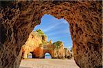 Natural Arch Rock Formations at Praia dos Tres Irmaos, Alvor, Portimao, Algarve, Portugal