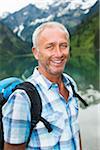 Portrait of mature man hiking at Lake Vilsalpsee, Tannheim Valley, Austria