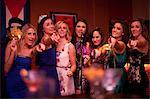 Young women singing in karaoke bar