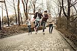 Five teenagers fooling around in park