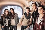 Five teenagers standing in underpass