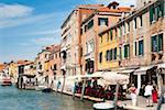 Waterfront buildings alongside canal in Venetian lagoon, Venice, UNESCO World Heritage Site, Veneto, Italy, Europe