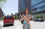 Woman on street parking bay holding digital tablet