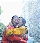 Happy couple hugging in rain