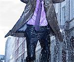 Businessman running in rain