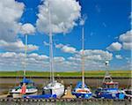 Boats in the Mud Flat Harbor in Summer, Tuemlauer-Koog, Schleswig-Holstein, Germany