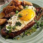 Bife a Cavalo; Brazilian Steak Topped with a Fried Egg; Potatoes