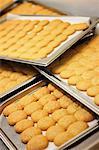 Fresh-baked amaretti on a baking tray