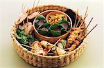 Pancake rolls and skewers in a basket