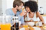 Man feeding food to her wife