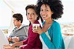 Portrait of two female friends enjoying coffee