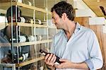 Smiling man holding a wine bottle