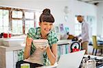 Woman using laptop at breakfast