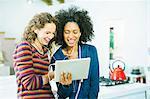 Women listening to earphones together