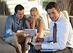 Financial advisor with couple on sofa