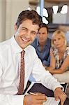 Financial advisor smiling with couple on sofa