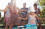 Girls hula hooping in backyard