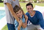 Family smiling in backyard