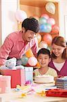 Family Celebrating Son's Birthday