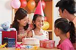 Family Celebrating Girl's Birthday