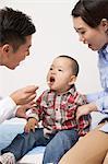 Doctor Examining Baby Boy In Office