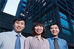 Portrait of three-business people outdoors, Beijing