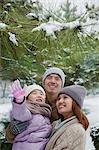 Family exploring in park in winter